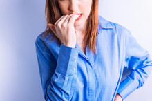 Portrait Beautiful Young Woman Biting Her Nails In Symbol Of Nervousness Or Hysteria. Nerves Concept
