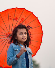 Portrait Of Girl With Red Umbrella