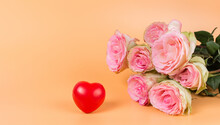 Beautiful Pink Roses And A Red Heart. A Holiday Card And A Declaration Of Love For Woman