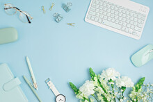 Home Office Desktop And Flowers. Modern Workspace With Notebook, Office Stationary. Freelance Business, Organization, Wedding Planning Flat Lay