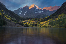 This Is The Pictures Of Maroons Bell With Lake During Sunrise At Aspen, Colorado