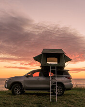 Sunset On The Beach Camping In Vehicle