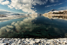 View Of Lake Against Mountain Range During Winter