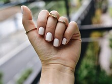 Close-up Of Person Hand With Manicure And Jewelry