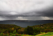 Wide Angle View From North Head Of The Entrance To Sydney Harbour During A Thunderstorm With The Sydney City Skyline In The Background.