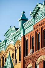 Unique Building Designs With Blue, Orange, And Gold