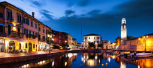 Boats In Old Town Port Of Lazise At Twilight. The Town Is A Popular Holiday Destination In Garda Lake District.
