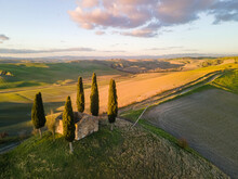 Abandoned Building In The Middle Of Tuscan Countryside Surrounded By Cypress Trees. Aerial View, Drone Shot.