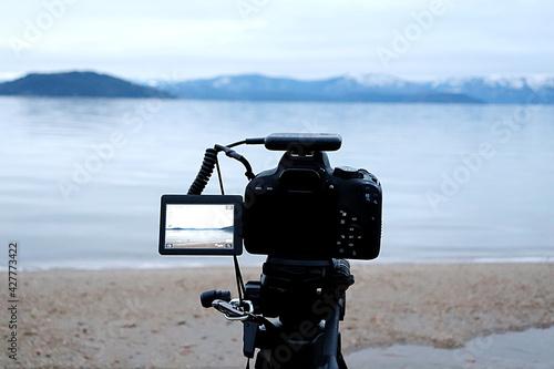 Valokuva Camera Photographing On Beach Against Sky