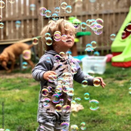 Fototapeta Sensory Sensitive Toddler Enjoying Bubbles obraz