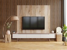Mockup A TV Wall Mounted In A Dark Room With A Dark Wood Wall.