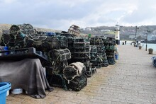 Panoramic Shot Of Crabs Traps  By Sea Against Sky In City