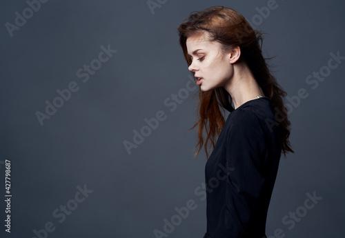 Elegant woman in black dress at evening model cropped view Fototapet