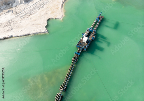 Aerial View Of The Long Boom Of A Suction Excavator In A Quartz Quarry For The Excavation Of Sand Fototapet