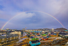 High Angle View Of Rainbow Over Buildings In City Against Sky