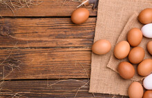 Fresh Eggs On An Old Wooden Table On An Organic Farm - Top View.