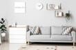Leinwandbild Motiv Modern living room with chest of drawers and sofa