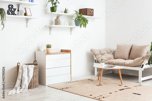 Modern living room with chest of drawers and sofa