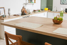 Dining Table With Apples In Interior Of Modern Kitchen