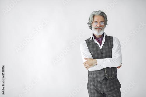 Fotografie, Obraz Handsome pensive mature businessman in formal suit