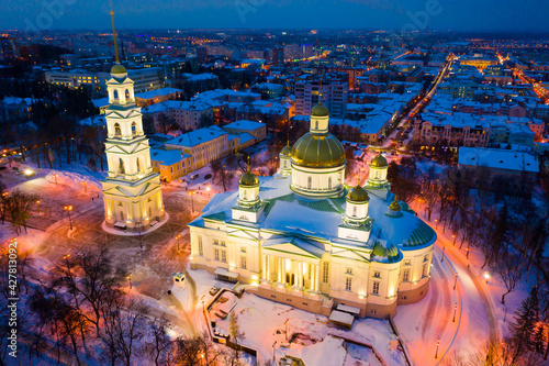 Fotografering Aerial view of lighted five domed church and bell tower of Spassky Cathedral in Penza in winter twilight, Russia