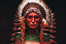 Tribal Woman Warrior With Headwear From Feathers In Dark Background