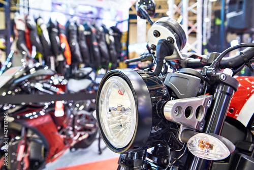 Obraz na plátně Motorcycle headlight in sport shop