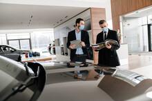 Salesman And Customer In A Car Dealership