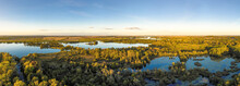 Aerial Scenic View Of Lake Against Sky At Sunset