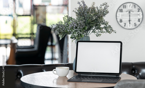 Blank screen tablet with keyboard on the table in comfortable room. - fototapety na wymiar