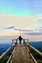 Rear View Of Man Standing At Observation Point Against Sky