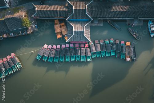 Fotografia, Obraz Aerial landscapes of Jinxi village, row of traditional wooden boat, a historic c