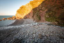 Long Exposure Of The River Heddon Flowing Into The Sea At Heddons Mouth In Exmoor National Park