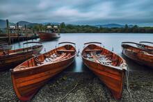 Sailboats Moored On Sea Against Sky