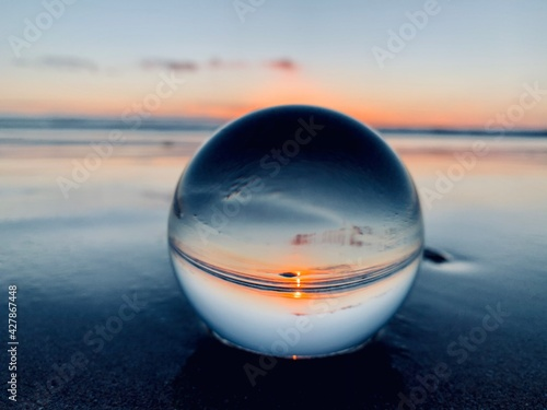 Close-up Of Water On Beach Against Sky During Sunset With Lense Ball - fototapety na wymiar