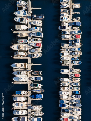 Aerial View Of Sailboats Moored In Sea Against Buildings In City Wallpaper Mural