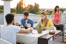 Young Friends Having Barbecue Party Outdoors In Home Terrace During Summer Time - Focus On Chef Woman Face