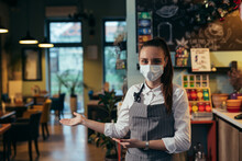 Waitress With Face Mask Welcome To Restaurant