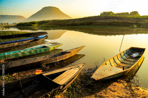 Canvas Fishing Boats Moored On Lake Against Sky