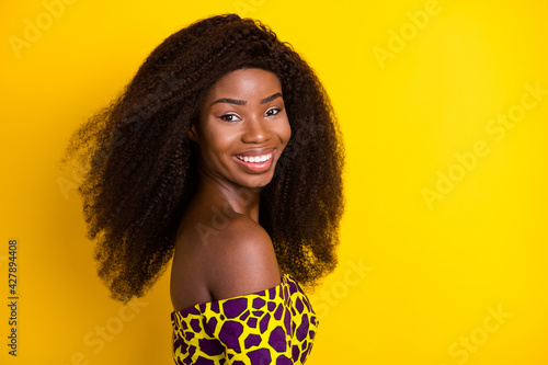 Fototapeta Profile side view portrait of attractive cheerful dreamy girl having fun isolated over bright yellow color background obraz