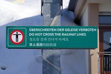 Sign At Rigi Mountain Railway Station Rigi Kulm No Trespassing Of Tracks In Different Languages. Photo Taken April 14th, 2021, Rigi, Switzerland.
