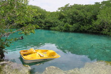 Crystal Clear Cenote In Yucatan Mexico, Spend Your Vacation Swimming And Diving In The Water Or Pedaling In A Little Yellow Pedal Boat, Freetime Activities