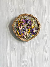 Handmade Panel Of Dried Flowers, Flowers, Wheat, Grass And Braids Hanging On The Wall. On A Light Wooden Background