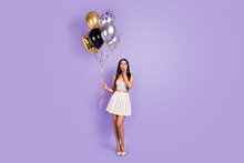Full Size Photo Of Charming Amazed Young Woman Hold Hand Cheek Balloons Isolated On Violet Color Background
