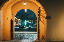 Illuminated Street Seen Through Door Of Building