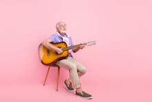 Full Length Body Size Dreamy Grandpa Playing Guitar Looking Copyspace Isolated On Pastel Pink Color Background