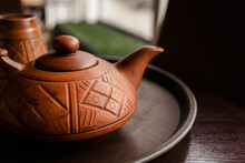 Clay Tea Pot With Sealed Arnament