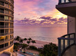 Amazing breathtaking beautiful sunrise sunset twilight dusk dawn hour at tropical paradise beach in Miami South Beach, Florida with picturesque nature, landscape and seascape scenery dream destination