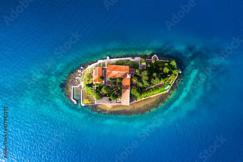 St. George Island. Kotor. Montenegro. Island in the sea in Montenegro. Bay of Kotor. Aerial view on the island. Adriatic sea. Seascape from drone at the summer time. Travel and holiday