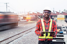 African Man Engineer Using Tablet To Report Of Train Timetables For Control A The Train On Railway